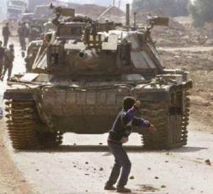 A rebellious Palestinian youth about to inflict severe property damage
